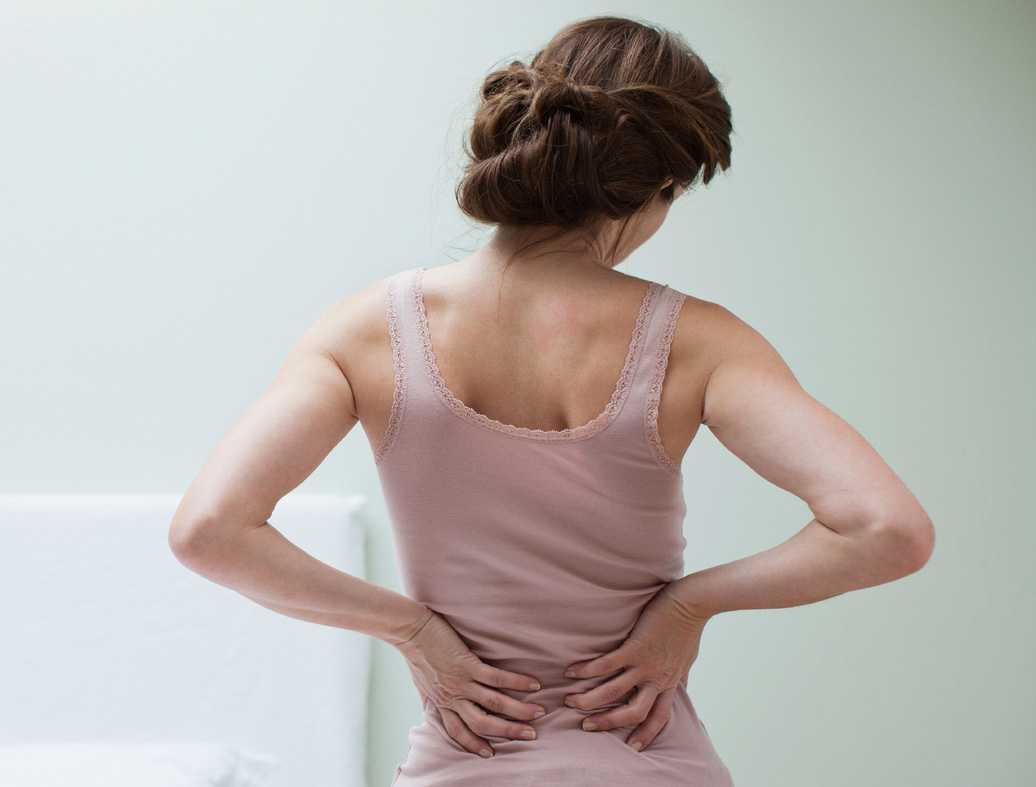 Боли в спине при беременности: норма или патология, что делать при ее возникновении, в чем опасность