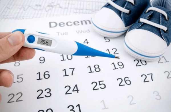 Календарик и градусник в руке